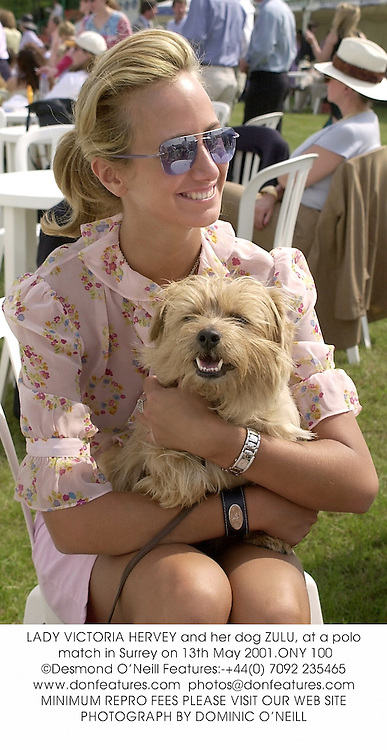 LADY VICTORIA HERVEY and her dog ZULU, at a polo match in Surrey on 13th May 2001.ONY 100