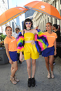 IMAGE DISTRIBUTED FOR ACCUWEATHER -  Chloe Schnell is shaded from the hot summer sun by the AccuWeather MinuteCast street team at New York Fashion Week, on Tuesday, Sept. 15, 2015. The AccuWeather MinuteCast Street Team is at it again helping Fashion Week attendees stay stylish and one-step ahead of any possible precipitation. (Photo by Diane Bondareff/Invision for AccuWeather/AP Images)