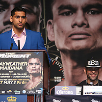 Boxer Amir Khan speaks at the podium during the undercard final press conference for the Mayweather & Maidana boxing match at the Hollywood Theater, inside the MGM Grand hotel on Thursday, May 1, 2014 in Las Vegas, Nevada.  (AP Photo/Alex Menendez)