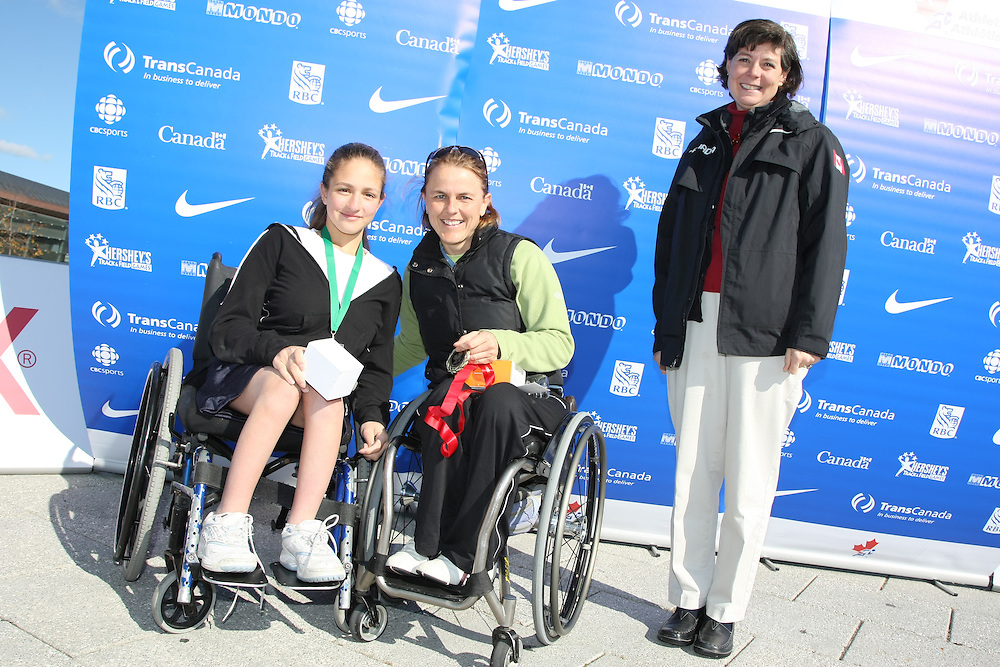 (Ottawa, ON---18 October 2008) The top finishers at the TransCanada 10k Canadian Road Racing Championships with Athletics Canada Head Joan Mortimer. From left to right: 2nd Sarah White; 1st--Diane Roy. Photograph Geoff Robins/Mundo Sport Images (www.msievents.com).