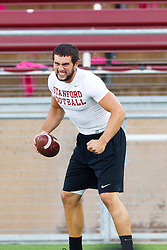 Oct 1, 2011; Stanford CA, USA;  Stanford Cardinal quarterback Andrew Luck (12) jokes in the end zone during warm ups before the game against the UCLA Bruins at Stanford Stadium.  Mandatory Credit: Jason O. Watson-US PRESSWIRE