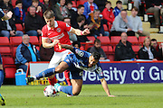 Charlton Athletic midfielder, Johann Berg Gudmundsson (7) battles for ball with Birmingham City midfielder, David Davis (26) during the Sky Bet Championship match between Charlton Athletic and Birmingham City at The Valley, London, England on 2 April 2016. Photo by Matthew Redman.