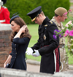 © licensed to London News Pictures. 25/06/2011. Windsor ,UK.  Prince WIlliam and Kate Middleton arrive at Victoria Barracks, Windsor, Berks on Armed Forces day today (25/06/2011) for a Welcome home parade for the Irish Guards following their tour of duty in Helmand province, Afghanistan. See special instructions. Mandatory photo credit Matt Cetti-Roberts/LNP