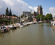 Grote Kerk cathedral church and boats in Nieuwe Haven, Dordrecht, Netherlands