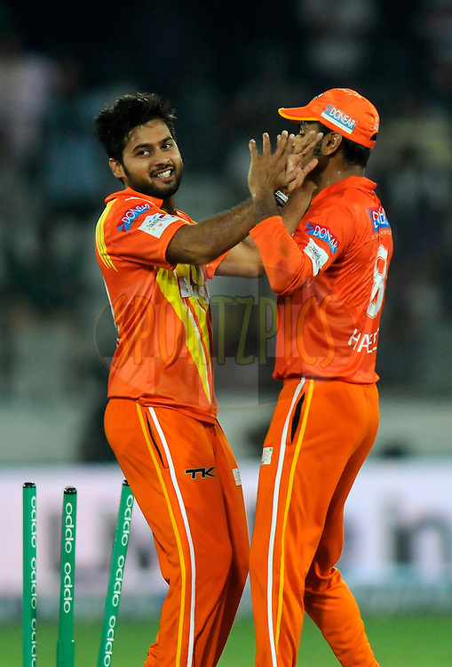 Mustafa Iqbal of Lahore Lions celebrates the wicket of Gautam Gambhir captain of Kolkata Knight Riders during match 7 of the Oppo Champions League Twenty20 between the Kolkata Knight Riders and the Lahore Lions held at the Rajiv Gandhi Cricket Stadium, Hyderabad, India on the 21st September 2014<br /> <br /> Photo by:  Pal Pillai / Sportzpics/ CLT20<br /> <br /> <br /> Image use is subject to the terms and conditions as laid out by the BCCI/ CLT20.  The terms and conditions can be downloaded here:<br /> <br /> http://sportzpics.photoshelter.com/gallery/CLT20-Image-Terms-and-Conditions-2014/G0000IfNJn535VPU/C0000QhhKadWcjYs