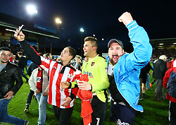Robert Olejnik of Exeter City is mobbed by fans at the final whistle - Mandatory by-line: Gary Day/JMP - 18/05/2017 - FOOTBALL - St James Park - Exeter, England - Exeter City v Carlisle United - Sky Bet League Two Play-off Semi-Final 2nd Leg
