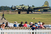 A Boeing B-17G Flying Fortress lands and taxis after a fly past - Duxford Battle of Britain Air Show at the Imperial War Museum. Also commemorating the 50th anniversary of the 1969 Battle of Britain film. It runs on Saturday 21 & Sunday 22 September 2019