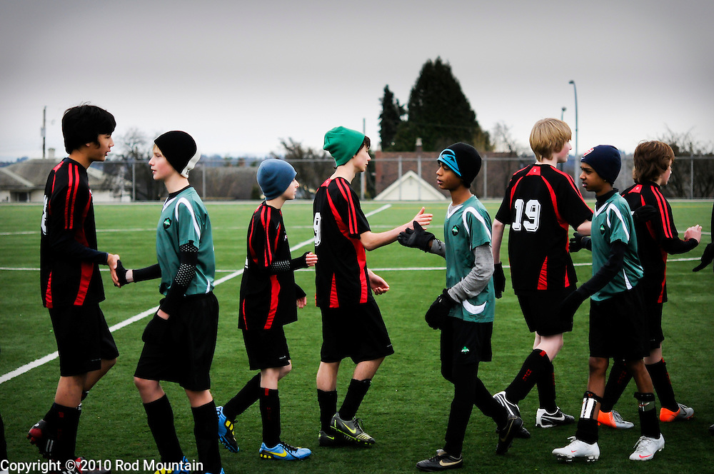 Burnaby, BC, Canada - December 11, 2010 - A group of boys lineup after a Soccer match to shake hands with the other team. <br />