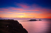 Worm's Head at sunset<br /> Rhossili<br /> Gower Peninsula<br /> Swansea County<br /> South<br /> Coastal Scenery