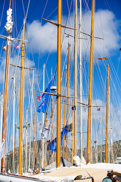Wooden masts line the dock in Falmouth Harbor Marina, host to the 2008 Antigua Classic Yacht Regatta. The yachts in this image are unidentifiable.  This race is one of the worlds most prestigious traditional yacht races. It takes place annually off the costa of Antigua in the British West Indies.