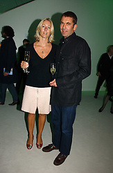 BILL AMBERG and SUSIE FORBES at an exhibition of David Hockney portraits at the National Portrait Gallery sponsored by Burberry on 11th October 2006.<br />