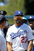 LOS ANGELES, CA - JUNE 30:  Matt Kemp #27 of the Los Angeles Dodgers laughs during fan photo day before the game against the New York Mets on Saturday, June 30, 2012 at Dodger Stadium in Los Angeles, California. The Mets won the game in a 5-0 shutout. (Photo by Paul Spinelli/MLB Photos via Getty Images) *** Local Caption *** Matt Kemp