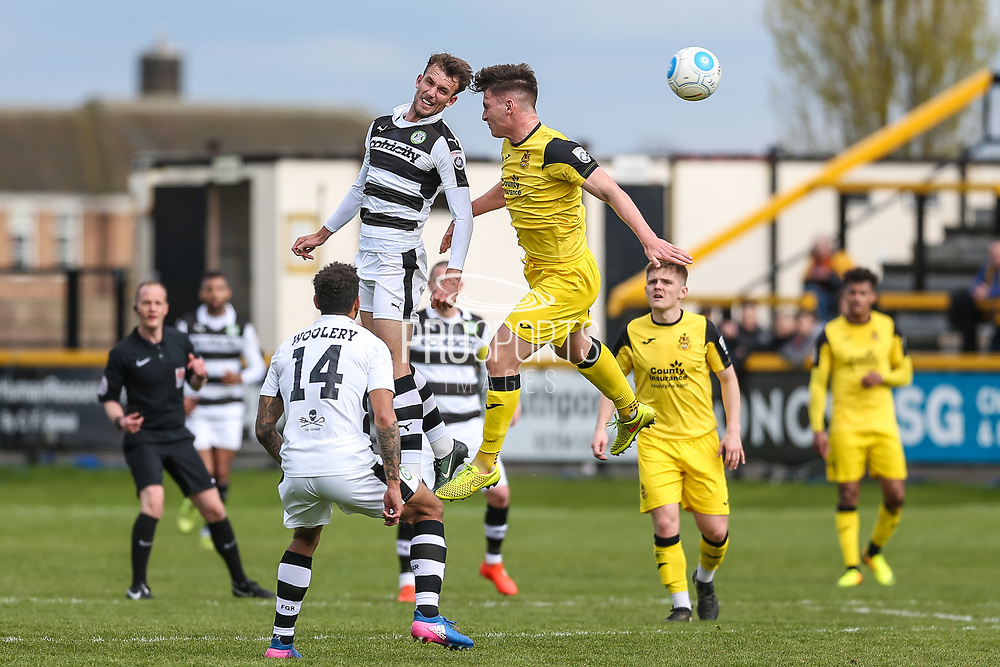 Forest Green Rovers Christian Doidge(9) and Southport's Ross White(2) challenge for the ball during the Vanarama National League match between Southport and Forest Green Rovers at the Merseyrail Community Stadium, Southport, United Kingdom on 17 April 2017. Photo by Shane Healey.