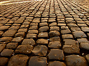 Cobbled stone floor detail from the entrance/courtyard to the Capitolini museums, in Rome, Italy. The museums themselves are contained within 3 palazzi as per designs by Michelangelo Buonarroti in 1536, they were then built over a 400 year period.