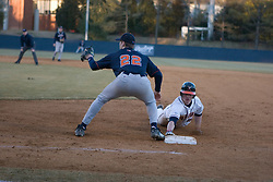Virginia Cavaliers catcher Beau Seabury (16) dives back to first against Bucknell.  The Virginia Cavaliers Baseball Team defeated the Bucknell University Bison 2-0 at Davenport Field in Charlottesville, VA on February 23, 2007.
