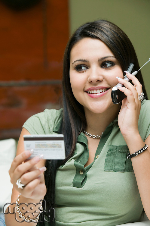 Woman Placing Credit Card Purchase on Cell Phone