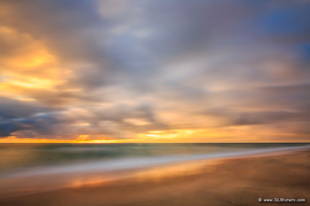 A one minute exposure of sunrise on a Kitty Hawk Beach on the Outer Banks, NC.