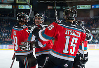 KELOWNA, CANADA - NOVEMBER 28:  Myles Bell #29, Jesse Lees #2 and Colton Sissons #15 of the Kelowna Rockets celebrate a goal against the Tri City Americans at the Kelowna Rockets on November 28, 2012 at Prospera Place in Kelowna, British Columbia, Canada (Photo by Marissa Baecker/Shoot the Breeze) *** Local Caption ***