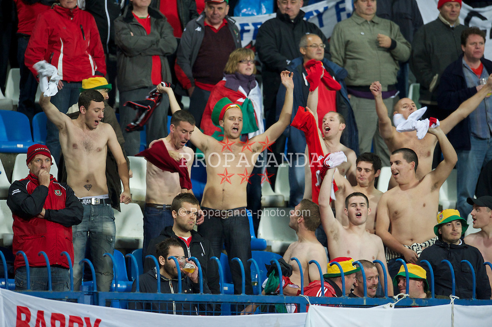 OSIJEK, CROATIA - Tuesday, October 16, 2012: Wales supporters enjoy themselves despite the 2-0 defeat by Croatia during the Brazil 2014 FIFA World Cup Qualifying Group A match at the Stadion Gradski Vrt. (Pic by David Rawcliffe/Propaganda)