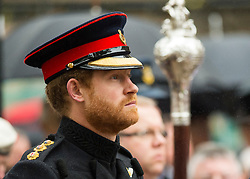 © Licensed to London News Pictures. 04/11/2015. London, UK. PRINCE HARRY during a minutes silence at the service. Service to mark the opening of the Filed of Remembrance at Westminster Abbey, attended by Prince Philip, Duke of Edinburgh and Prince Harry.  The Field of remembrance is a memorial garden to commemorate British and Commonwealth military and civilian servicemen and women in the two World Wars and later conflicts. Photo credit: Ben Cawthra/LNP