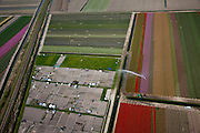Nederland, Noord-Holland, Gemeente Harenkarspel, 28-04-2010; Westfriese Dijk, onderdeel van de  .Westfriese Omringdijk, de vroegere zeewering, gezien naar de Hondsbossche zeewering. .Westfriese Dijk, part of the 'Westfrisian Surrounding Dike',the Hondsbossche  Seawall at the horizon.luchtfoto (toeslag), aerial photo (additional fee required).foto/photo Siebe Swart