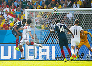 Mats Hummels of Germany (L white) scores their first goal during the 2014 FIFA World Cup match between France and Germany at the Maracana Stadium, Rio de Janeiro<br />