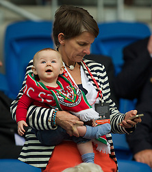 CARDIFF, WALES - Tuesday, August 21, 2014: A young Wales supporter before the FIFA Women's World Cup Canada 2015 Qualifying Group 6 match at the Cardiff City Stadium. (Pic by Ian Cook/Propaganda)