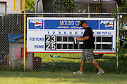 The scoreboard at Mound City is changed after the third inning in a Shrine Tournament game.