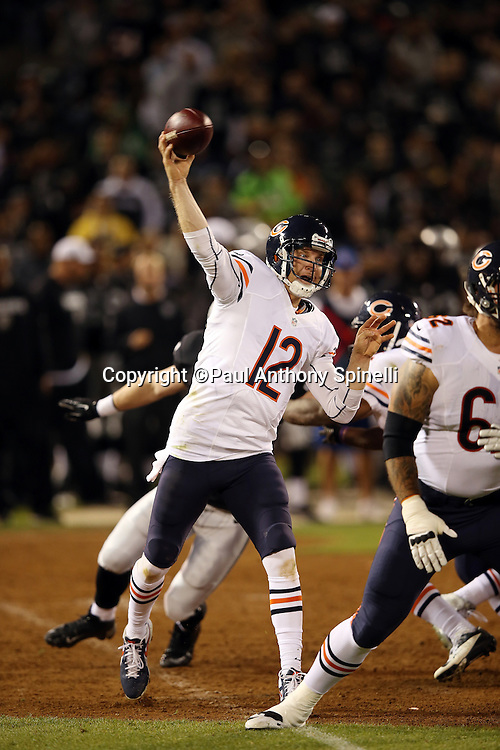 Chicago Bears quarterback Josh McCown (12) throws a pass during the NFL preseason week 3 football game against the Oakland Raiders on Friday, Aug. 23, 2013 in Oakland, Calif. The Bears won the game 34-26. ©Paul Anthony Spinelli