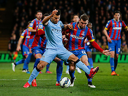 Sergio Aguero of Manchester City is challenged by James McArthur of Crystal Palace - Photo mandatory by-line: Rogan Thomson/JMP - 07966 386802 - 06/04/2015 - SPORT - FOOTBALL - London, England - Selhurst Park - Crystal Palace v Manchester City - Barclays Premier League.