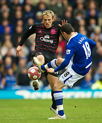 BIRMINGHAM, ENGLAND - Saturday, March 13, 2010: Everton's captain Phil Neville and Birmingham City's Keith Fahey during the Premiership match at St Andrews. (Photo by David Rawcliffe/Propaganda)