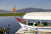 A boat wight he Ethiopian flag on Hawassa lake in Ethiopia.