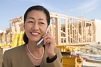 Architect talking on mobile phone and using laptop