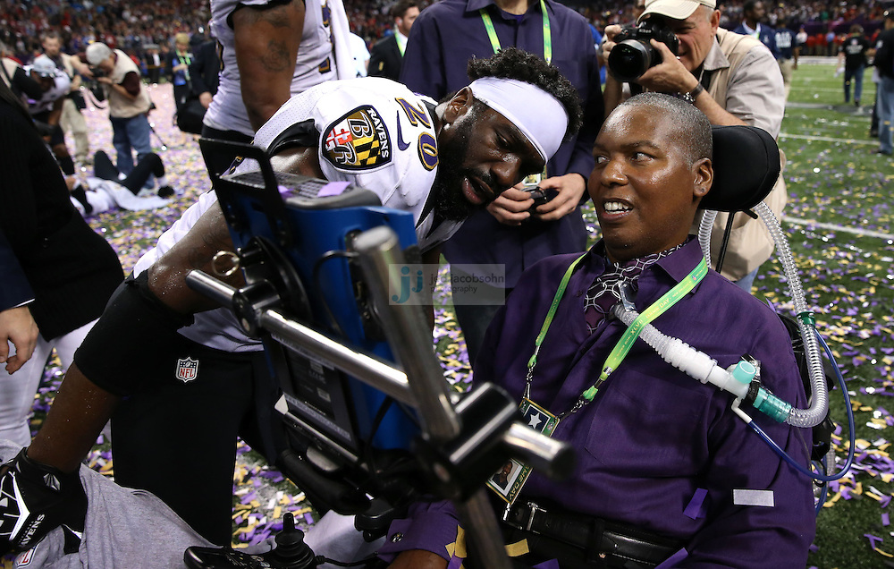 Ed Reed (20) of the Baltimore Ravens speaks with O.J. Brigance after defeating the the San Francisco 49ers during the NFL Super Bowl XLVII football game in New Orleans on Feb. 3, 2013. The Ravens won the game, 34-31.  (Photo by Jed Jacobsohn)