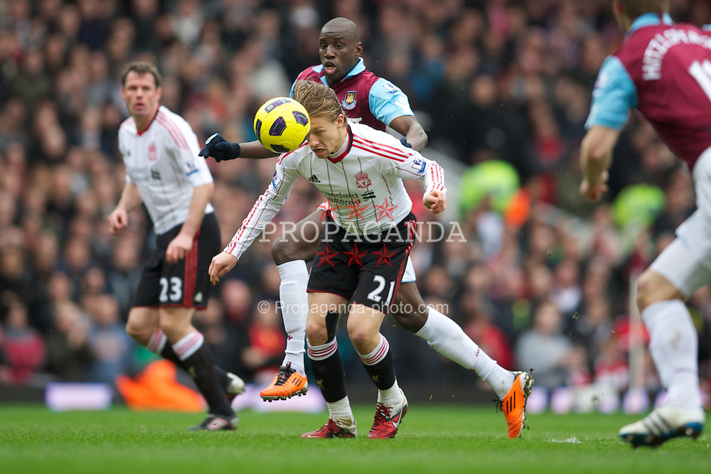 LONDON, ENGLAND - Sunday, February 27, 2011: Liverpool's Lucas Leiva and West Ham United's Valon Behrami during the Premiership match at Upton Park. (Photo by David Rawcliffe/Propaganda)