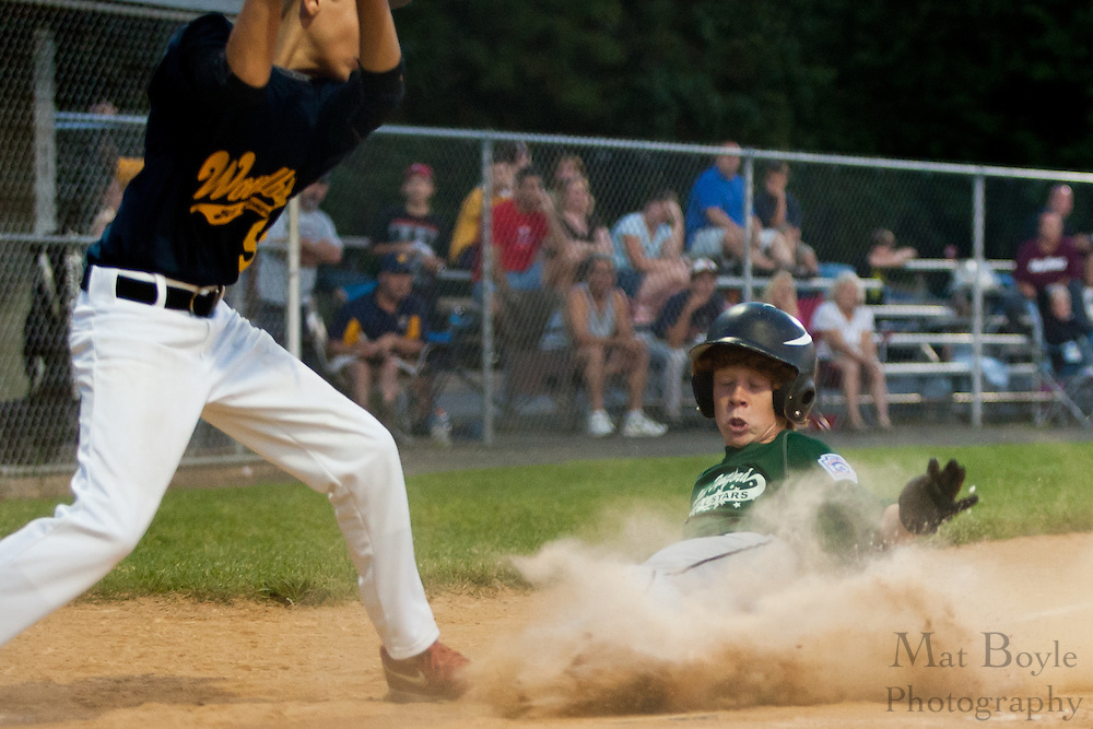 West Deptford's Drew Wilden slides into home on a past ball steal during the District 15 Little League final against Woodbury held in Clayton on Thursday July 14th.