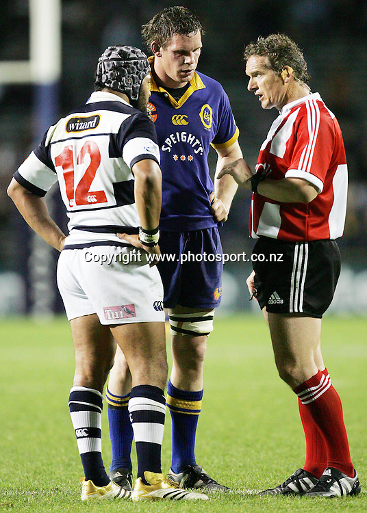 Referee Paul Honiss talks to Sam Tuitupou and Josh Blackie during the Air NZ Cup week 9 rugby match between Auckland and Otago at Eden Park, Auckland, New Zealand on Saturday 23 September, 2006. Auckland won the match 48-7. Photo: Hannah Johnston/PHOTOSPORT<br /><br /><br /><br /><br />230906