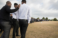 © Licensed to London News Pictures. 04/09/2016. London, UK. Relatives and friends line up to pay respect at a joint funeral held at Winn's Common Park for five men who drowned at Camber Sands last month.  The five men: Kurushanth Srithavarajah, brothers  Kenigan and Kobi Nathan, Inthushan Sri and Nitharsan Ravi were all friends from London.  They got into difficulty in the sea of Camber Sands on August 24. Photo credit: Peter Macdiarmid/LNP