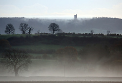 © Licensed to London News Pictures. 15/11/2014. Burton, UK Sunrise over King Alfred's Tower, Mid Somerset near Bruton today 15th November 2014. The forecast is for Sunshine and showers in the west and south. Photo credit : Jason Bryant/LNP