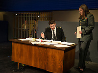 """Riley Alward Lt. Daniel Kaffee and Cici Zarella Lt. Jackie Ross during a scene at Guantanamo Base at dress rehearsal for """"A Few Good Men"""" with Gilford High School Monday afternoon.  (Karen Bobotas/for the Laconia Daily Sun)"""