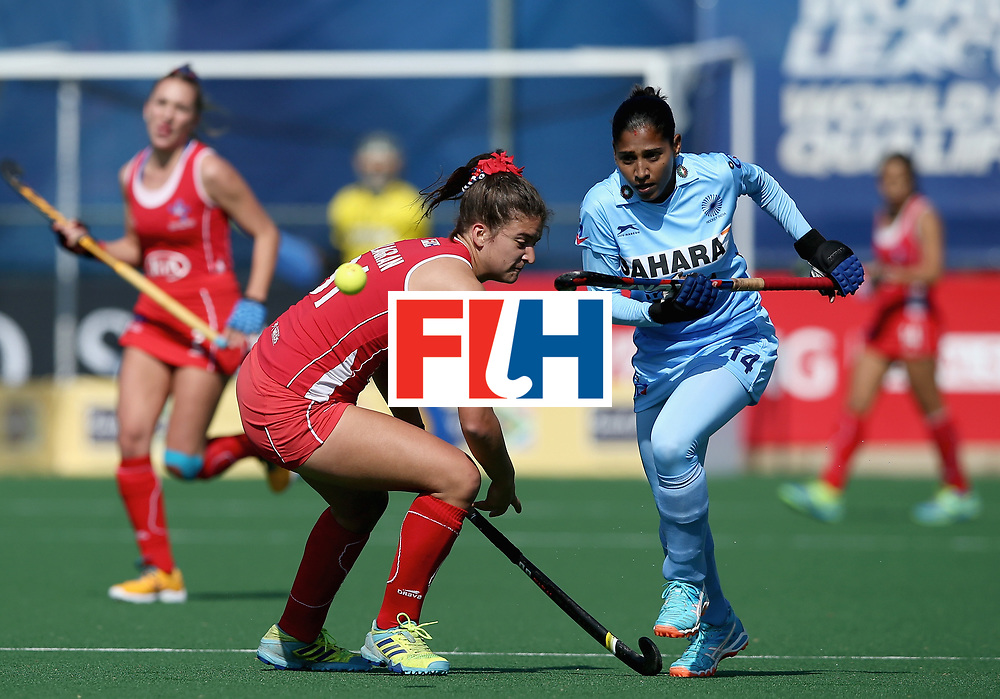 JOHANNESBURG, SOUTH AFRICA - JULY 12: Fernanda Villagran of Chile and Ritu Rani of India battle for possession during day 3 of the FIH Hockey World League Semi Finals Pool B match between India and Chile at Wits University on July 12, 2017 in Johannesburg, South Africa. (Photo by Jan Kruger/Getty Images for FIH)