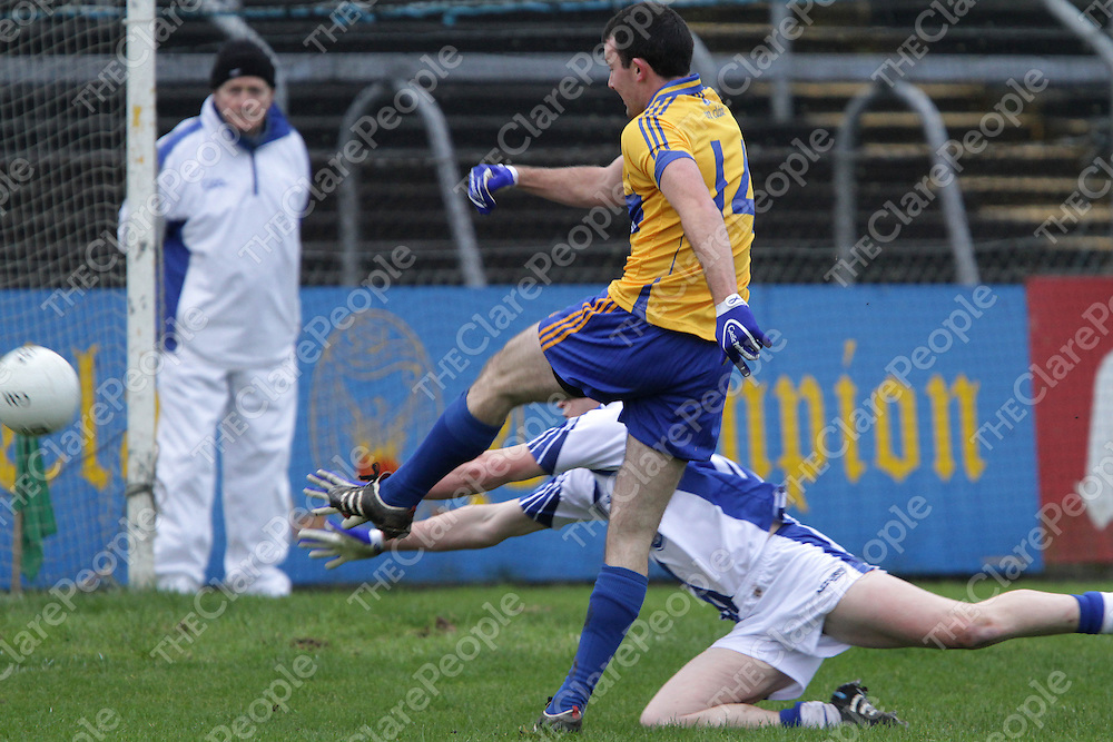 Clare's David Tubridy gets his shot on goal despite the attempted block down of Waterford's Shane Biggs in their Division 4 clash @ Cusack Park. - Photograph by Flann Howard