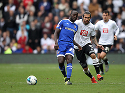 Toumani Diagouraga of Brentford passes while being chased down by Bradley Johnson of Derby County - Mandatory byline: Robbie Stephenson/JMP - 07966 386802 - 03/10/2015 - FOOTBALL - iPro Stadium - Derby, England - Derby County v Brentford - Sky Bet Championship