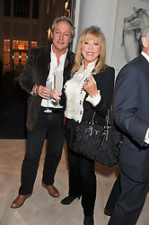ROD WESTON and PATTIE BOYD at a party to celebrate the publication of Fame Game by Louise Fennell held at Grace, West Halkin Street, London on 12th March 2013.