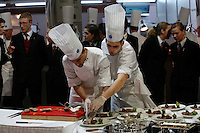 Philippe MILLE, left,  - France, with meat before judging - bocuse d'or..Owen Franken for the NY Times..January 28, 2009.