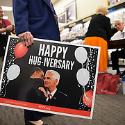 On the fifth anniversary of the day then Republican Governor Charlie Crist hugged newly elected Democratic President Barack Obama Crist autographs his newly published book at Books-a-Million in Fort Myers, Fla.  Protestors were holding the signs outside and this one was brought in for a Crist's autograph to be sold at a democratic fundraiser in the near future.  <br /> <br /> Profile of the former governor Charlie Crist on the campaign trail running for governor in Florida.