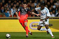 FOOTBALL - FRENCH CHAMPIONSHIP 2009/2010 - L1 - OLYMPIQUE MARSEILLE v OLYMPIQUE LYONNAIS - 21/03/2010 - PHOTO PHILIPPE LAURENSON / DPPI - TAYE TAIWO (OM) / ANTHONY REVEILLERE (OL)