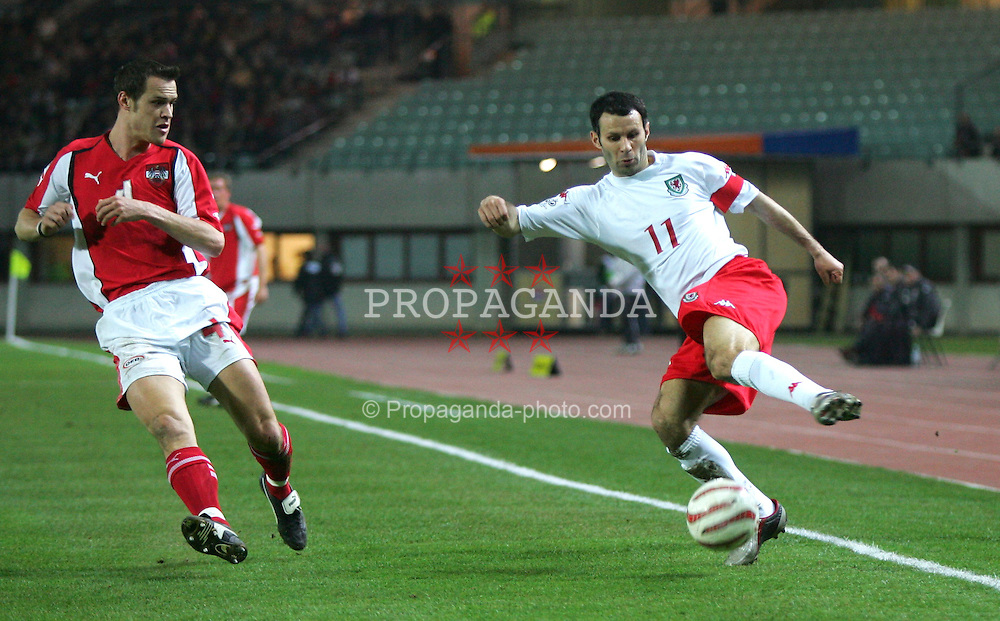 VIENNA, AUSTRIA - WEDNESDAY MARCH 30th 2005: Wales' Ryan Giggs and Austria's Ernst Dospel during the World Cup Qualifying Group Six match at the Ernst Happel Stadium. (Pic by David Rawcliffe/Propaganda)