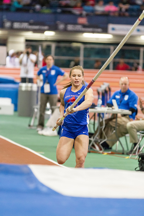 Girl's Pole Vault, won by Desiree Freier, TX, with new national HS indoor record 14' 2 3/4""
