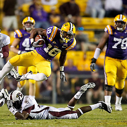 November 13, 2010; Baton Rouge, LA, USA; LSU Tigers running back Richard Murphy (18) leaps over Louisiana Monroe Warhawks safety Darius Prelow (37)during the second  half at Tiger Stadium. LSU defeated Louisiana-Monroe 51-0.  Mandatory Credit: Derick E. Hingle
